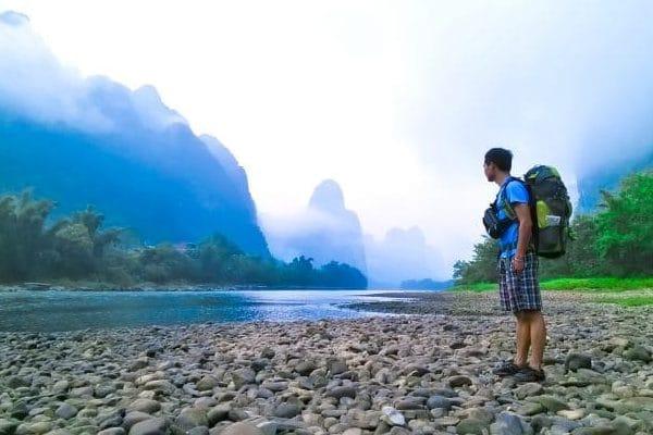 hiking along the riverside in yangshuo