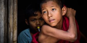 a-young-novice-looking-out-yangon-myanmar