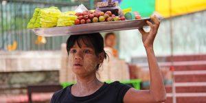 a-young-vendor-at-yangon-local-market