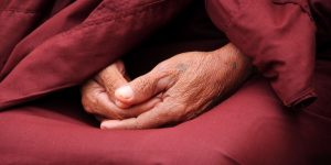 an-old-monk-in-meditation-with-hands-putting-together