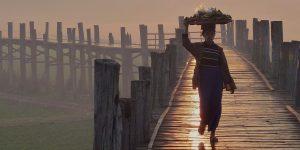 a-local-woman-walking-on-u-bein-bridge-at-sunset