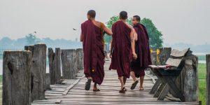 young-monks-walking-on-u-bein-bridge-in-amarapura-in-mandalay