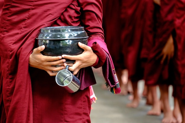 monks-waiting-for-alms-at-mahagandayon-monastery-in-mandalay