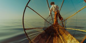 a-local-fisherman-on-his-boat-in-inle-lake