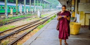 a-young-monk-waiting-for-the-train-in-yangon