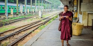 a-local-monk-on-the-train-platform-in-yangon
