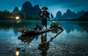 Cormorant Fishermen in Guilin China in the Blue Hour after Sunset