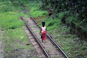 a-local-woman-walking-on-the-train-track