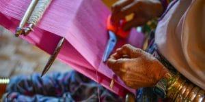 a-long-neck-woman-weaving-in-inle-lake