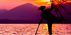 silhouette-of-a-fisherman-in-inle-lake