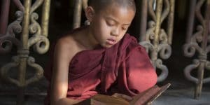 novice-reading-a-book-at-shwe-yan-pyay-monastery