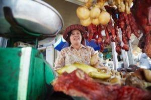 a-happy-vendor-at-russian-market-in-phnom-penh