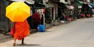 a-monk-walking-on-the-street-of-phnom-penh
