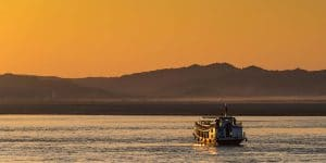cruising-at-sunset-on-the-irrawaddy-river
