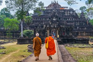 two-monks-walking-up-to-baphuon-temple